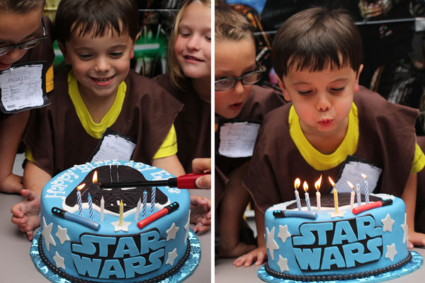 Star Wars birthday cake with Darth Vader and lightsabers