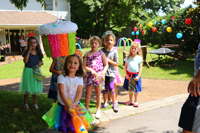 Rainbow party games with rainbow pinata